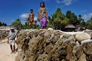 Kirarenti Muller and wife Totibure on their sea wall protecting their home back right of pic in the village of Temwaiku on the island of Tarawa. Photo: Justin McManus, The Age