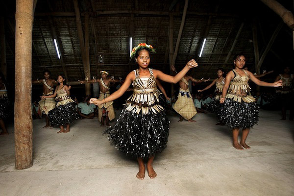 Local IKiribati children perform the Te Buke dance. They face an uncertain future as their islands capacity to support the population diminishes. Photo: Finn Frandsen, Politiken