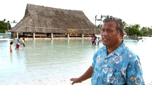 Rev. Eria Mwaerere and his community's mwaneaba, which is monthly threatened by rising tides.