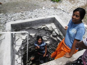 Gathering freshwater from a well in Kiribati.