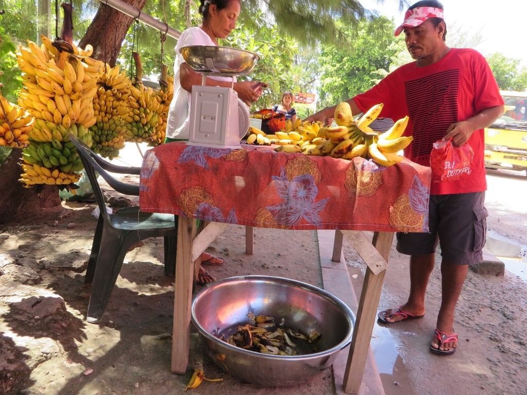 Selling bananas on a busy morning