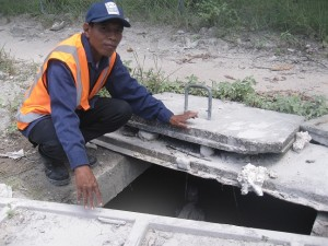 Evire Banririe, PUB Water Reticulation Secnior Technician, checks the Water Air Release Valve
